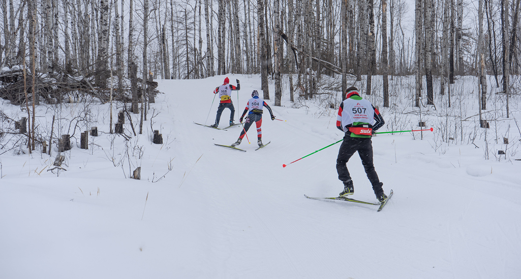 Skiers heading back out on the trail at the Don Allen Saskaloppet near La Ronge Saskatchewan