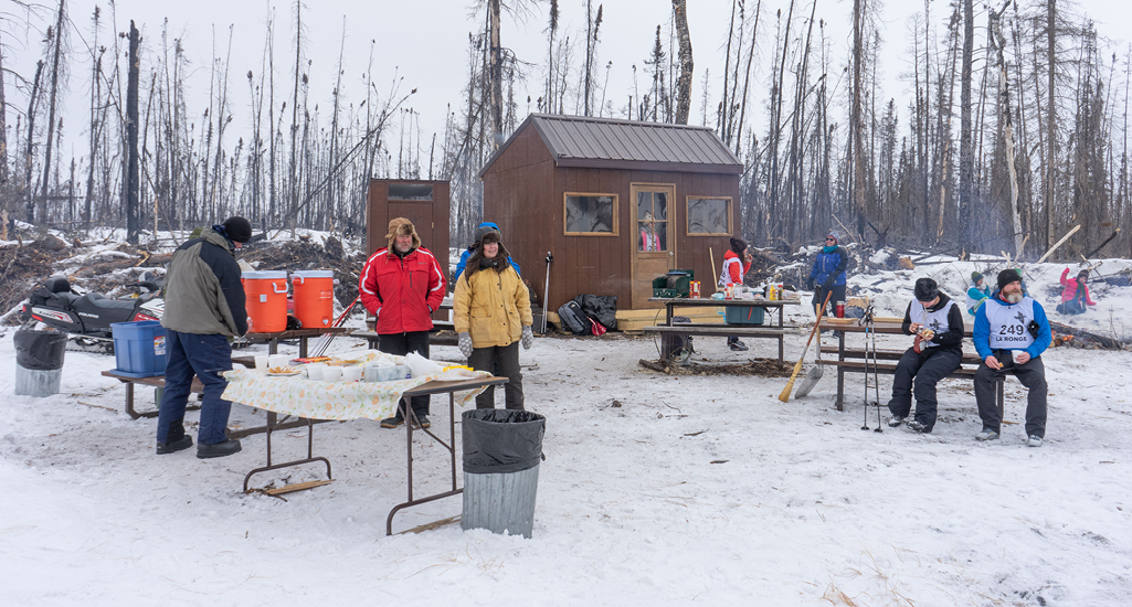 A group of volunteers help fuel hungry skiers at the Don Allen Saskaloppet near La Ronge Saskatchewan