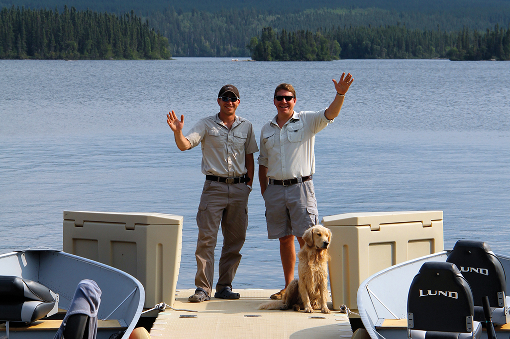 brothers standing on dock in northern saskatchewan